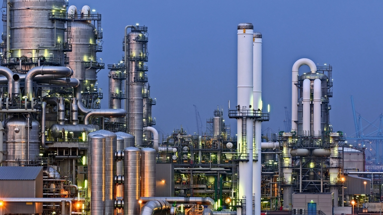 Oil refinery by night, landscape view