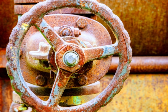 rusty water valve on an old boiler